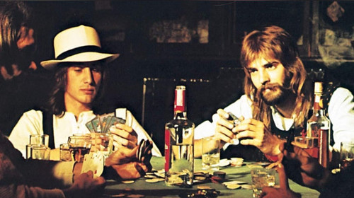 Loggins & Messina playing cards at a table